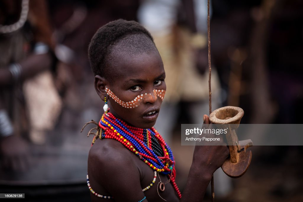 CONTENT] portrait of a hamer boy tribe with his face painted during the ceremony bull jumping. Bull jumping ceremony is a rite of passage ceremony for men coming of age must be done before a boy is permitted to marry. The boy must jump the cows four times to be successful. This test is performed while naked except for a few cords bound across the chest as a symbol of the childhood he is about to leave behind him. On completion of this test, the young man joins the others boys who have recently passed the same test and who spend the next few months of their lives supervising these events in villages throughout the Hamar territory. The ceremonies end with several days of feasting, including the typical jumping dances, accompanied by as much sorghum beer as the bull-jumper's family can provide to the visitor.