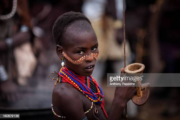CONTENT] portrait of a hamer boy tribe with his face painted during the ceremony bull jumping Bull jumping ceremony is a rite of passage ceremony for...