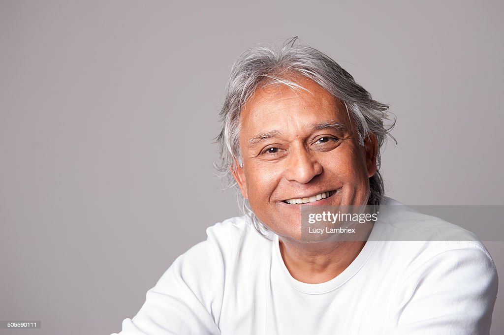 Portrait of a handsome and smiling mature man