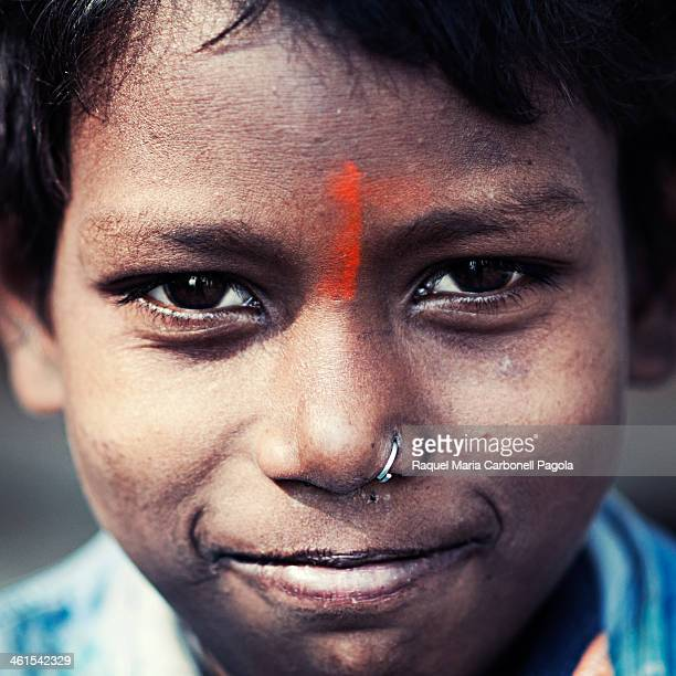 Portrait of a handsome Indian boy with a bindi and a nose ring