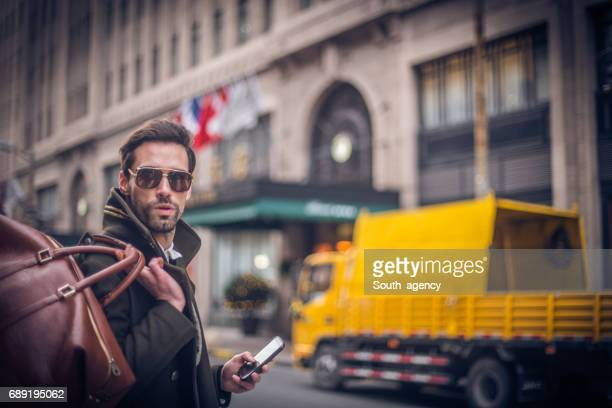 Portrait of a handsome man using a phone