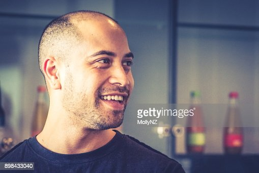 Portrait of a handsome Maori businessman in the workplace. : Stock Photo