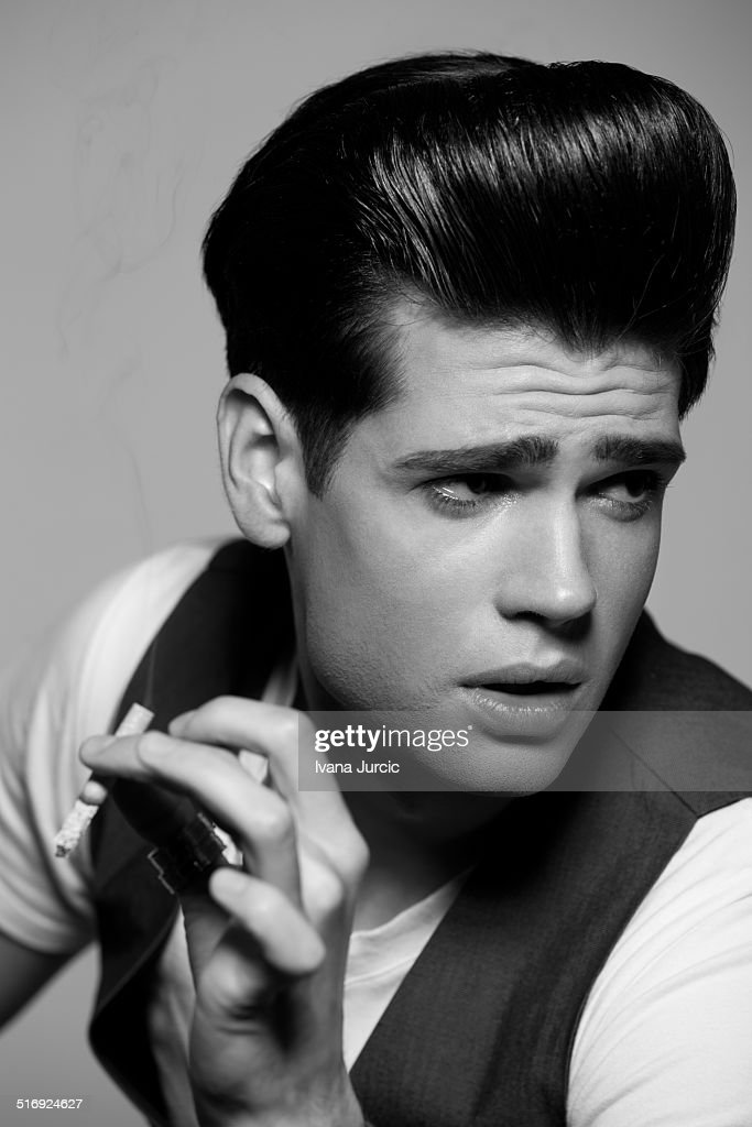 portrait of a handsome rockabilly man stock photo getty images. Black Bedroom Furniture Sets. Home Design Ideas