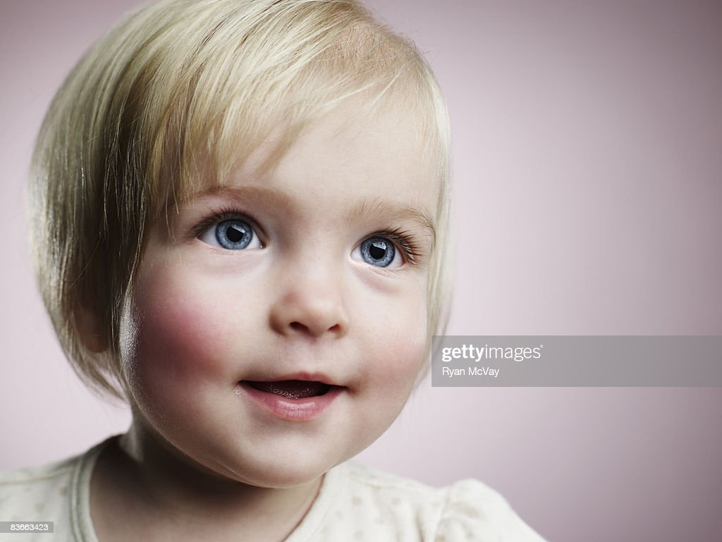 Portrait of a happy 1 year old girl. : Stock Photo