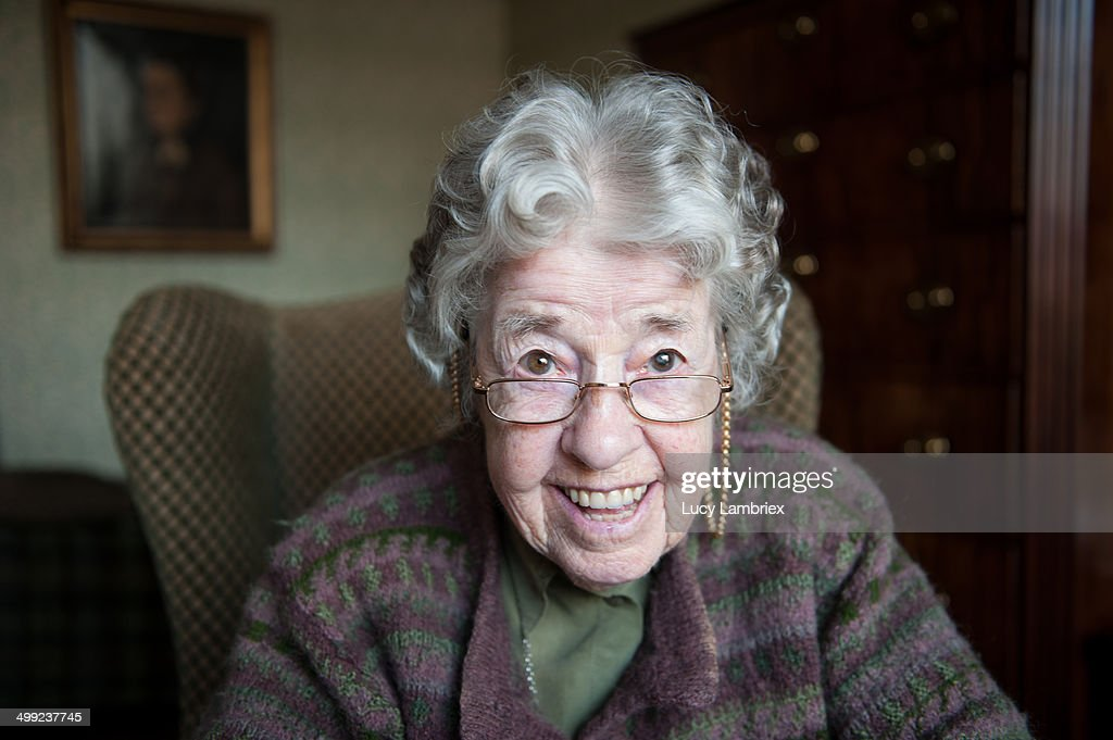 Portrait of a happy 97-year-old lady looking up