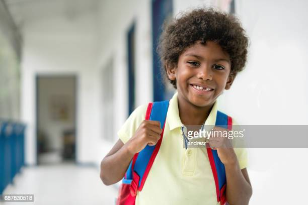 Portrait of a happy African American boy at the school