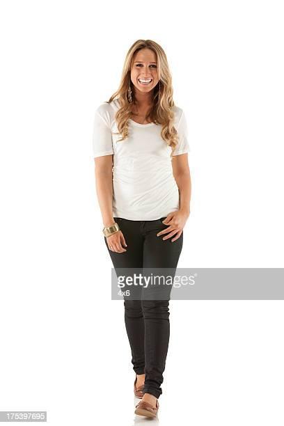 Portrait of a happy beautiful woman walking