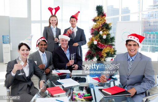 Portrait of a happy business team toasting with Champagne at a Christmas party : Stock-Foto