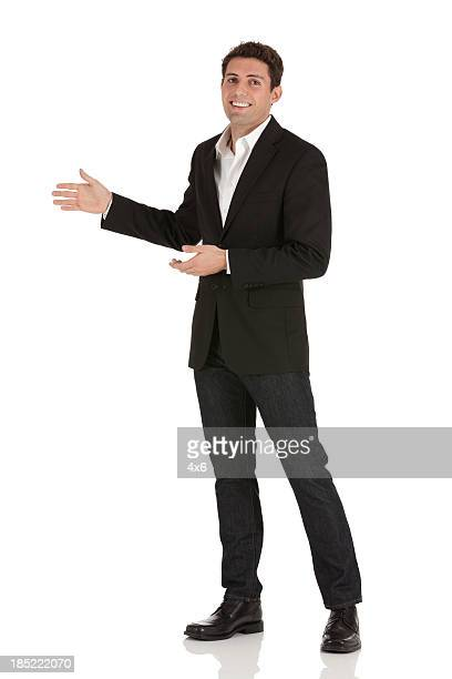 Portrait of a happy businessman gesturing