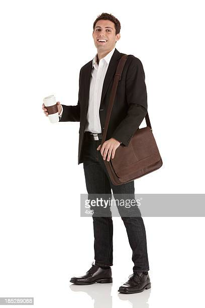 Portrait of a happy businessman with coffee
