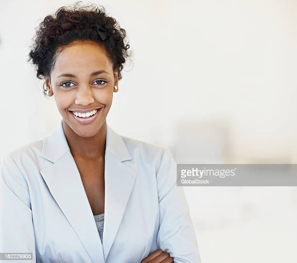 Portrait of a happy dark skinned business woman smiling