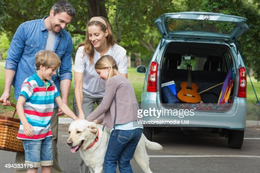 Family with kids and pet dog at picnic : Stock-Foto