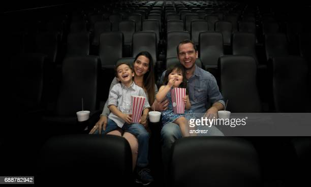Portrait of a happy family watching a movie at the cinema