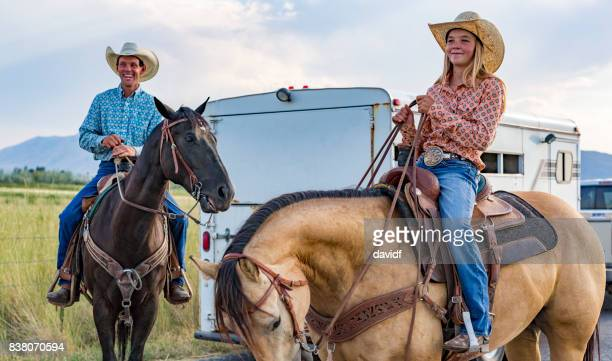 Portrait of a Happy Father and Daughter on Horseback