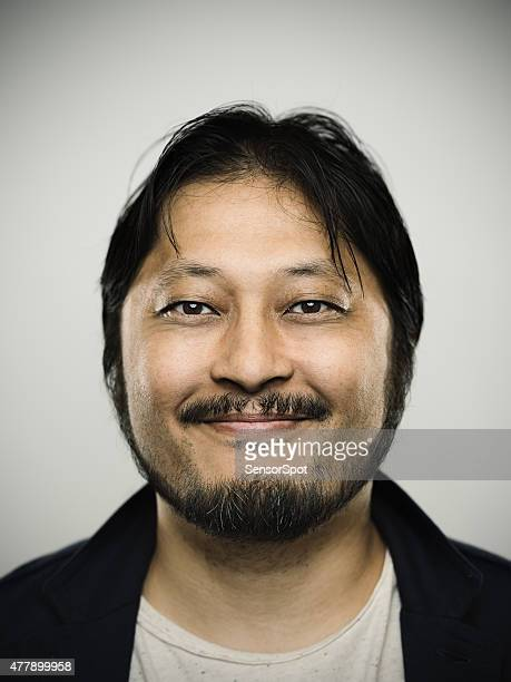 Portrait of a happy japanese man looking at camera