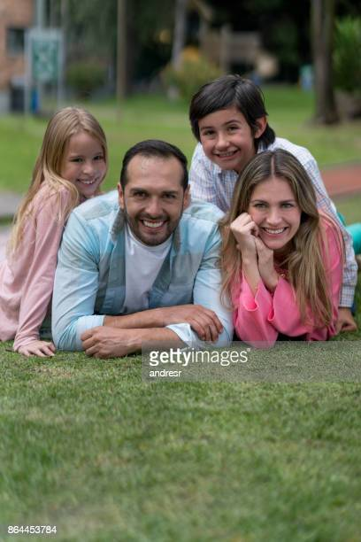 Portrait of a happy Latin American family at the park