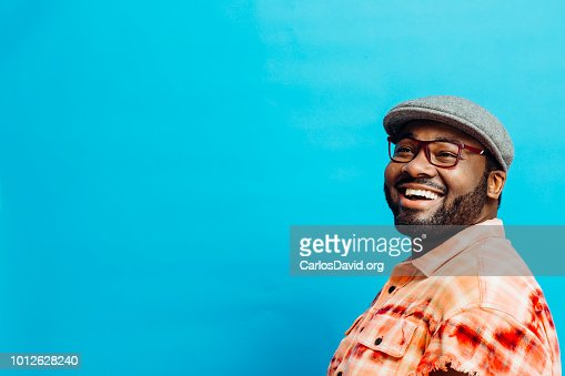 Portrait of a happy man in orange shirt looking up : Foto stock