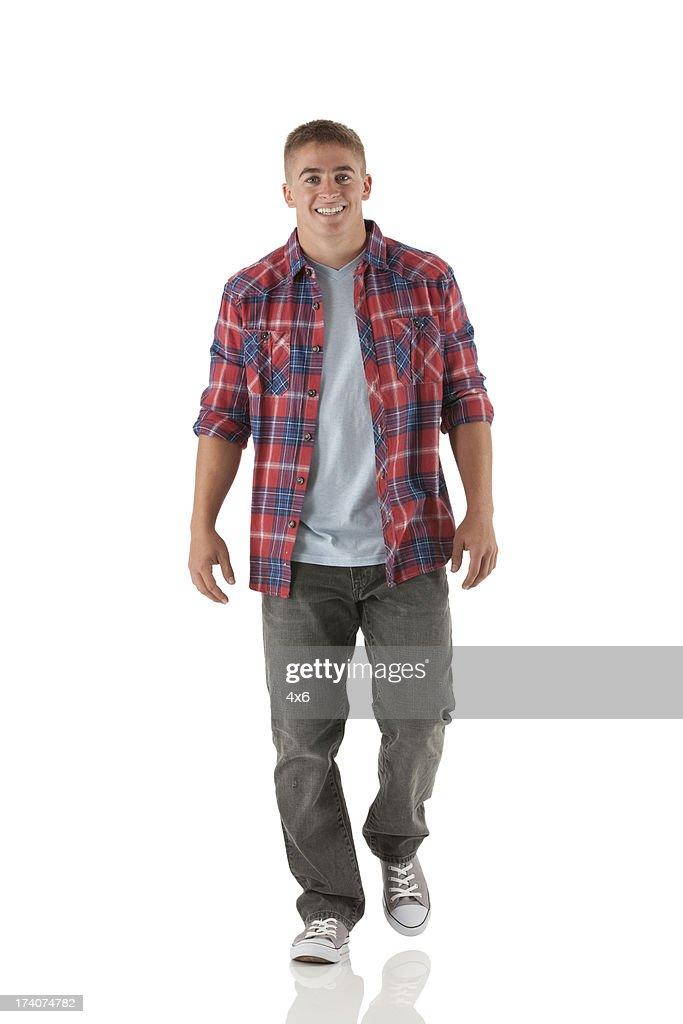 Portrait of a happy man walking : Stock Photo