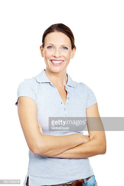 Portrait of a happy mature lady standing against white