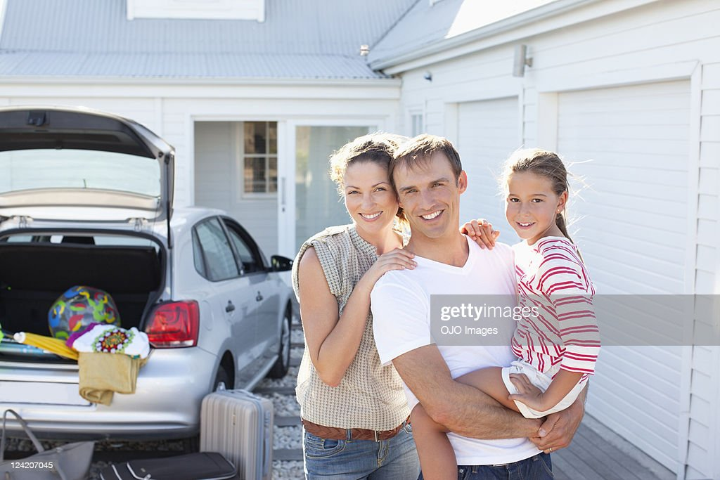 Portrait of a happy mid adult couple smiling with cute daughter : Stock Photo