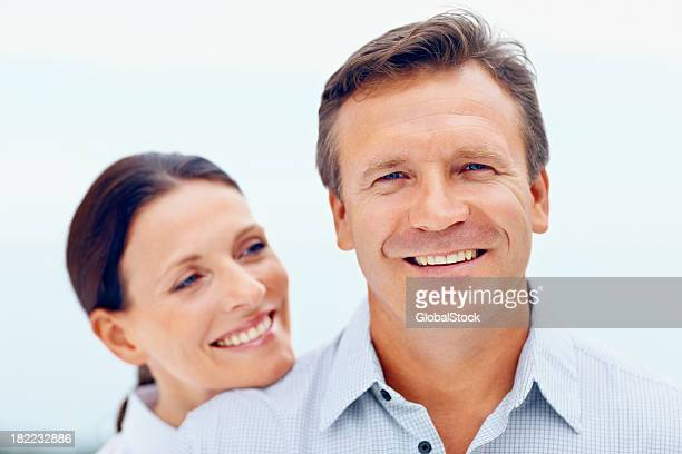 Portrait of a happy middle aged couple isolated on white
