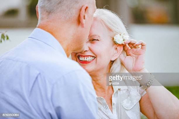 Portrait of a happy senior couple embracing and kissing