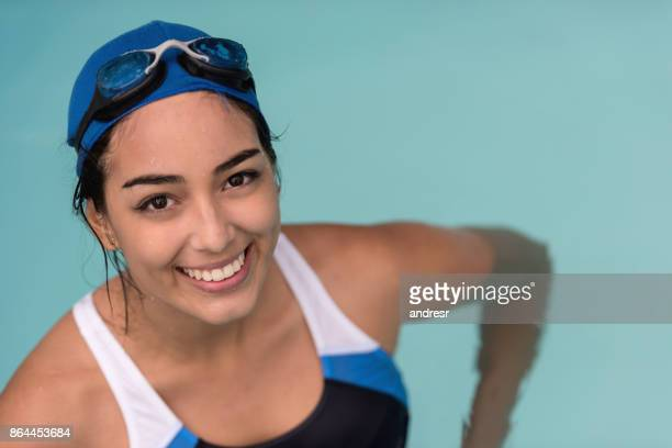 Portrait of a happy woman swimming in the pool