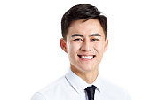 head shot of a young asian businessman, happy and smiling, studio shot, isolated on white background.