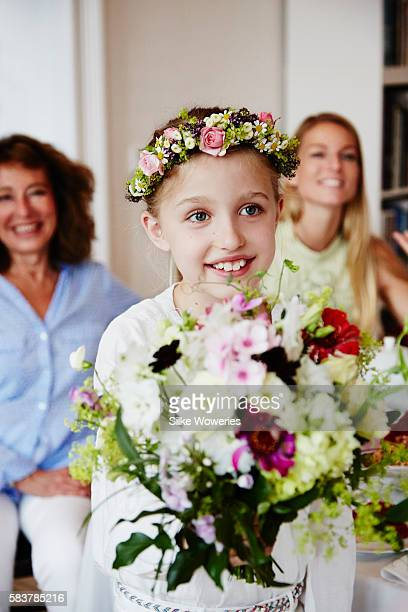 portrait of a happy young girl giving away a bouquet of flowers