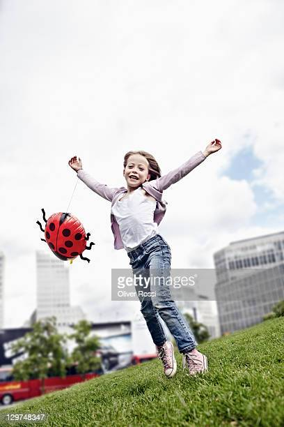portrait of a happy young girl with a balloon