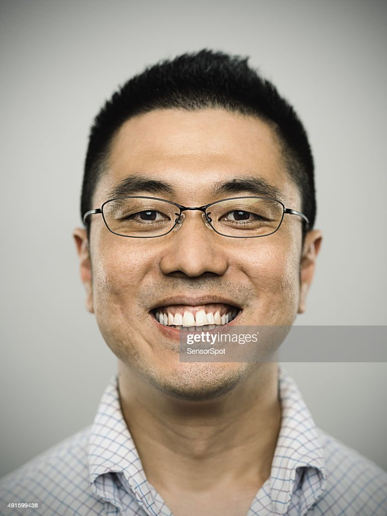 Portrait of a happy young japanese man looking at camera : Stock Photo