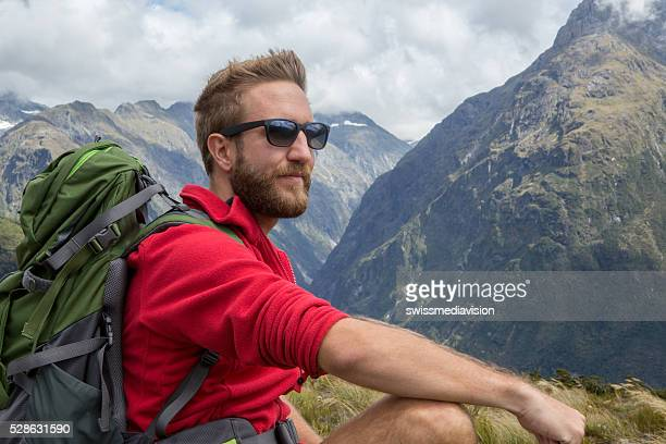 Portrait of a hiker resting on mountain top