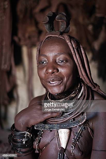 Portrait of a Himba woman in her hut