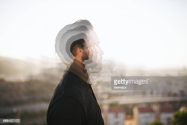 Portrait of a hipster with double exposure technique