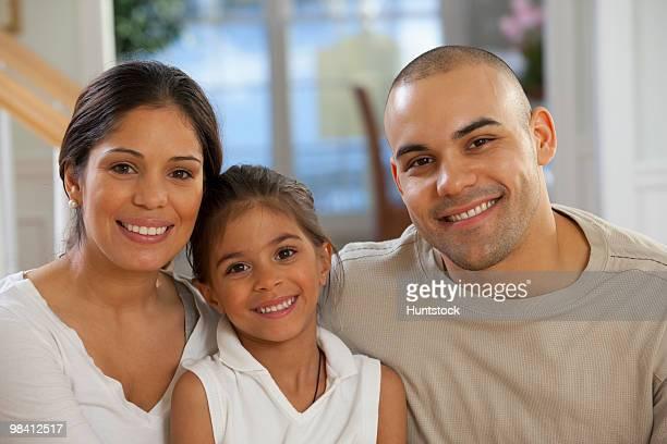 Portrait of a Hispanic family smiling