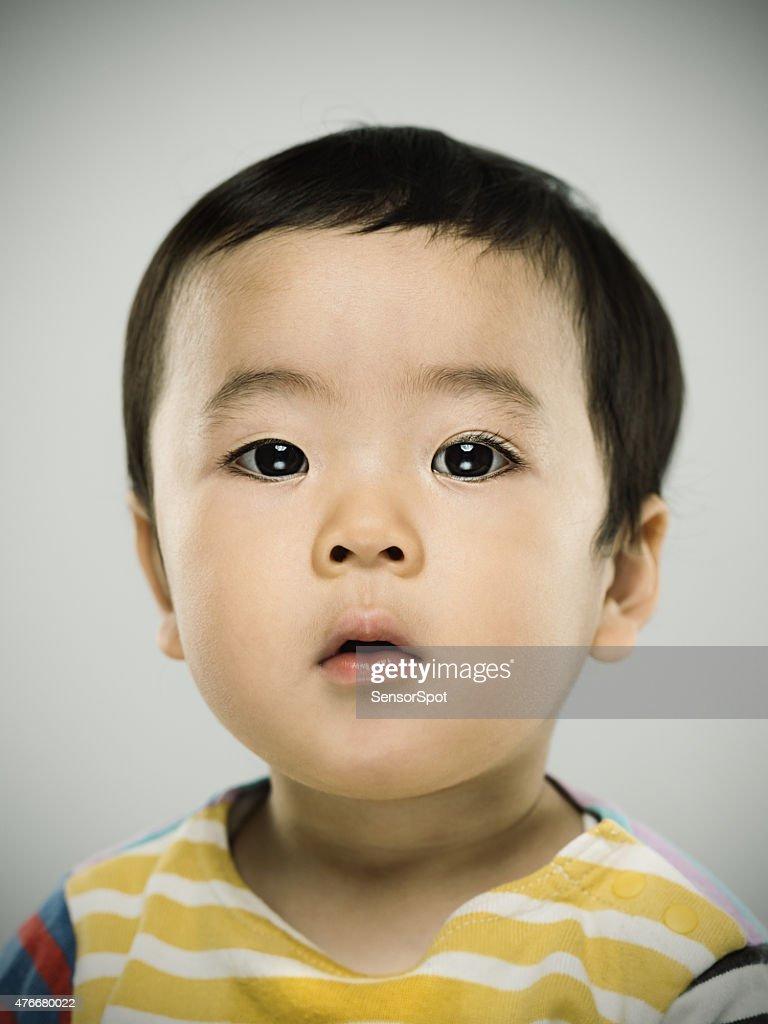 Portrait of a japanese baby looking at camera