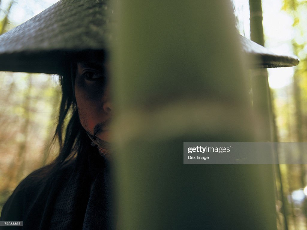 Portrait of a Japanese man in cone hat : Stock Photo