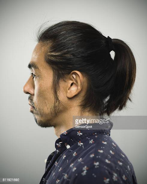 Portrait of a japanese man looking at camera