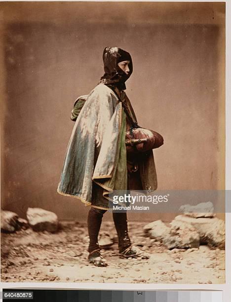 A portrait of a Japanese man wearing regional winter costume Japan ca 1890s