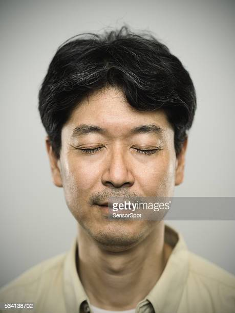 Portrait of a japanese man with pensive expression.