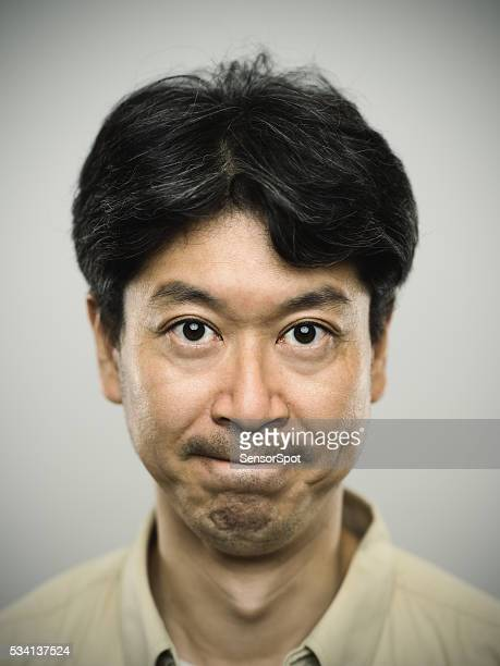 Portrait of a japanese man with severe expression.
