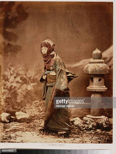 A portrait of a Japanese woman wearing regional winter costume Japan ca 1890s