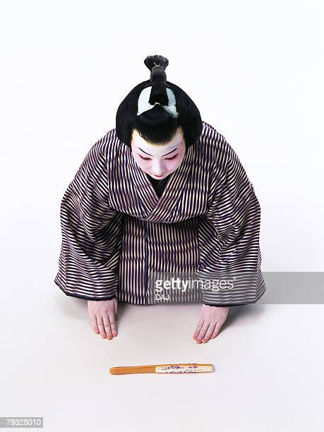 Portrait of a Kabuki actor sitting down and bowing, High Angle View