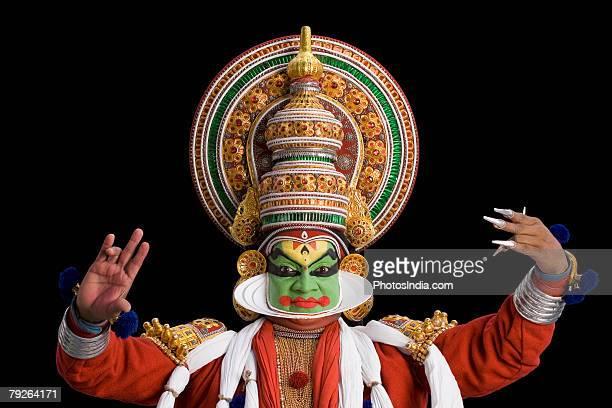 Portrait of a Kathakali dance performer dancing
