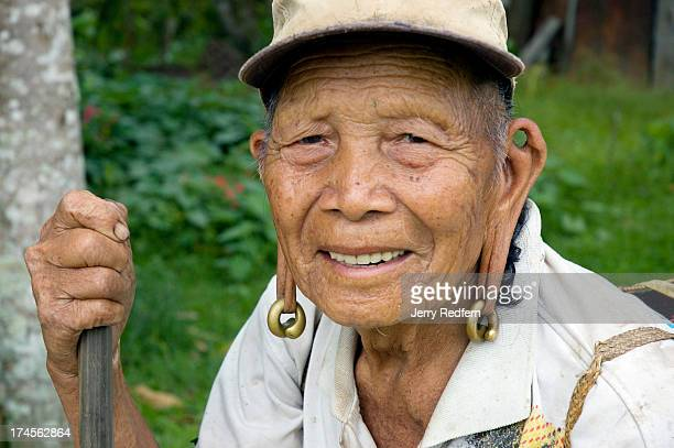 Portrait of a Kelabit elder with distended earlobes formed by wearing massive brass earrings for years For centuries the Kelabit people have lived...
