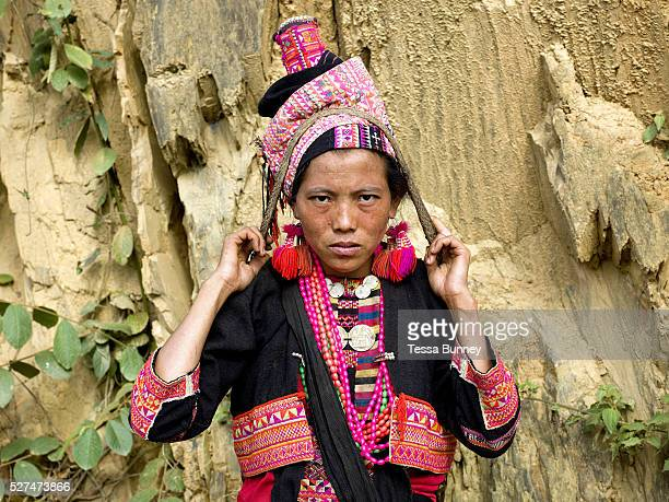 A portrait of a Ko Pala ethnic minority woman carrying a headstrap basket at Pak Nam Noi market Phongsaly Province Lao PDR One of the most ethnically...
