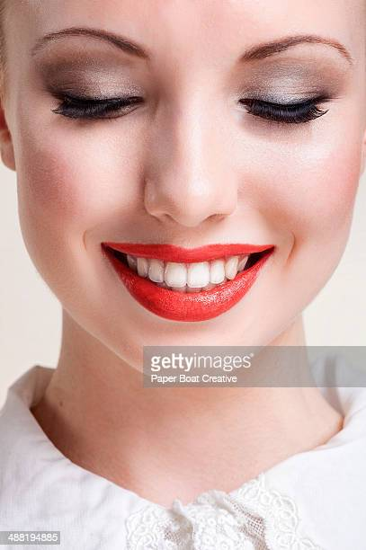 Portrait of a lady smiling with bright red lips