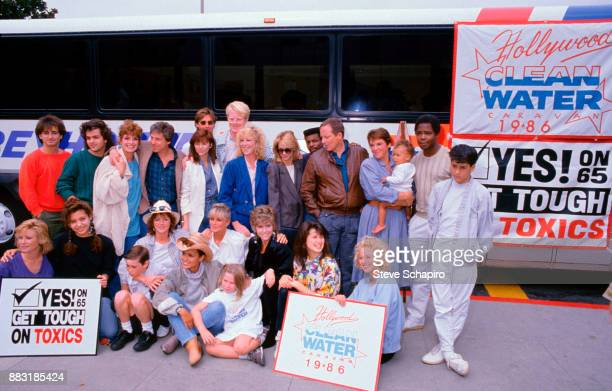 Portrait of a large group of celebrities as they poses in front of the Hollywood Clean Water Caravan bus California 1986 Among those pictured are...