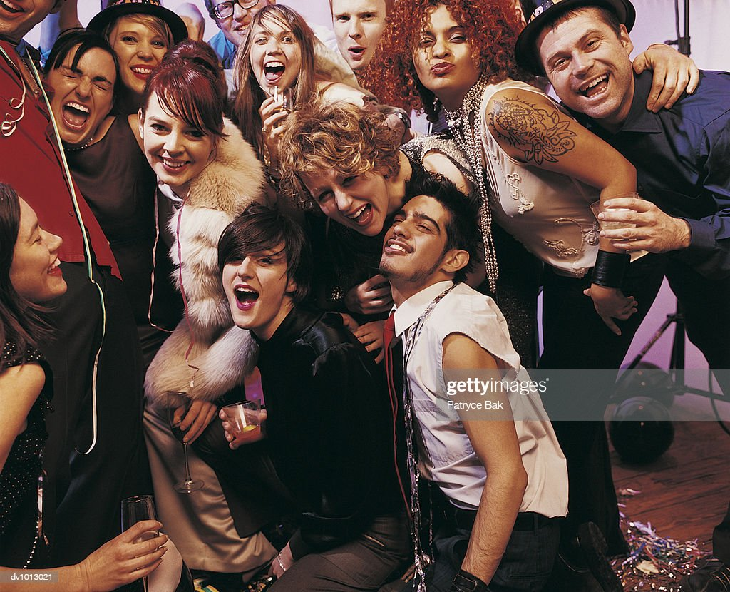 Portrait of a Large Group of Young Adults at a Drunken Party : Stock Photo
