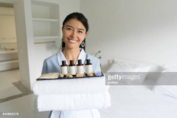 Portrait of a Latin American cleaner working at a hotel